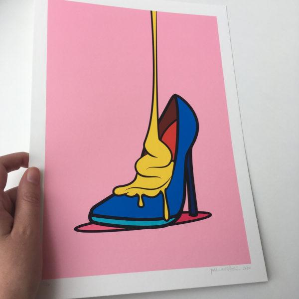 Hand holding shoe art print - Solleveld & Toim
